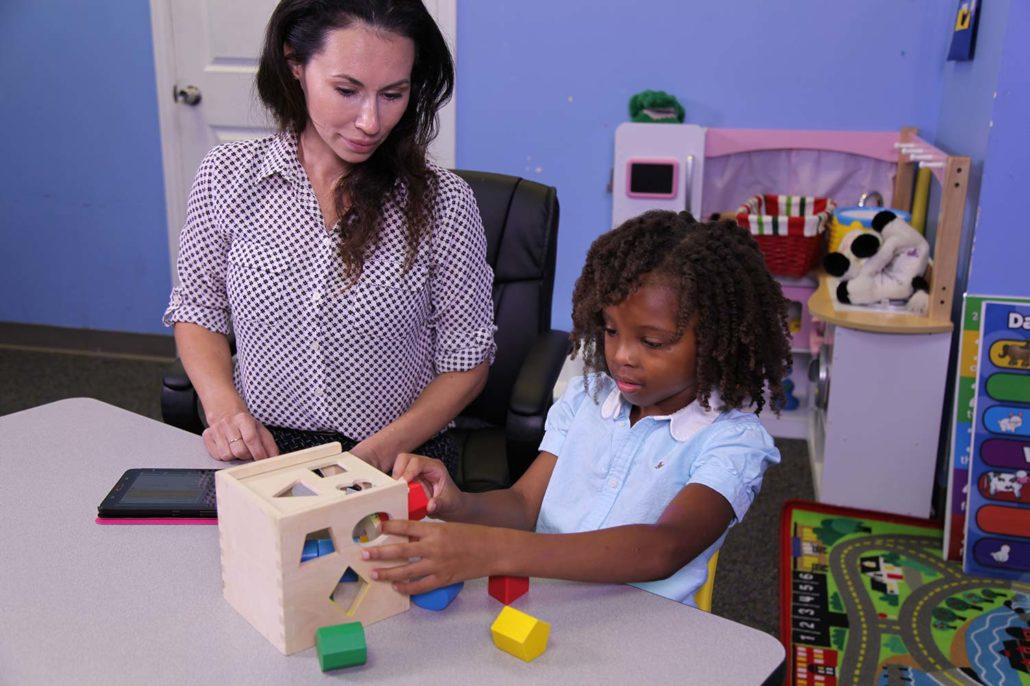 ABA Therapy Houston | Teacher and student using shape sorter
